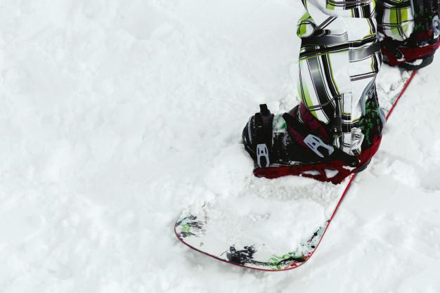 close-up-ski-boots-white-snowboard_8353-1065